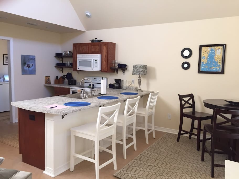 Open kitchen with dining area.