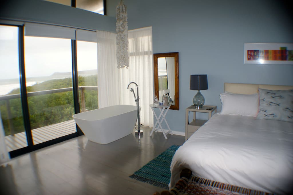 Main en-suite bedroom with sea views and free-standing bath (King Bed)