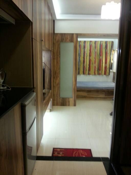 Taken from entry: kitchen > living room > bedroom