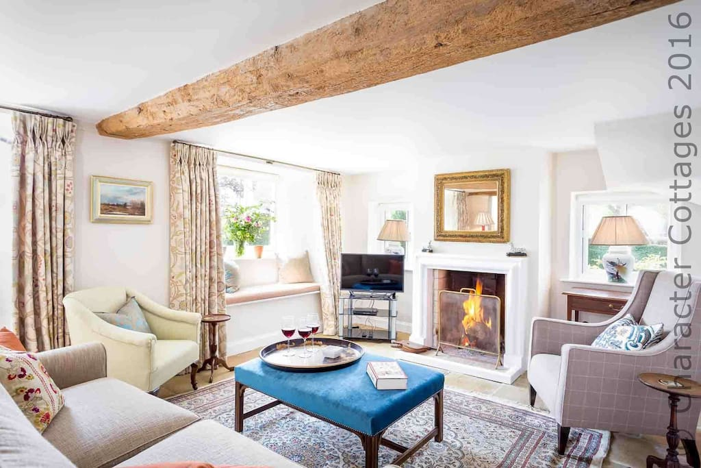 Wonderful, country style living room, with real fire