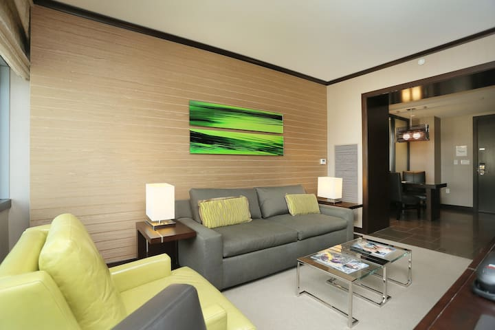Living space, pull-out sofa-bed and arm-chair