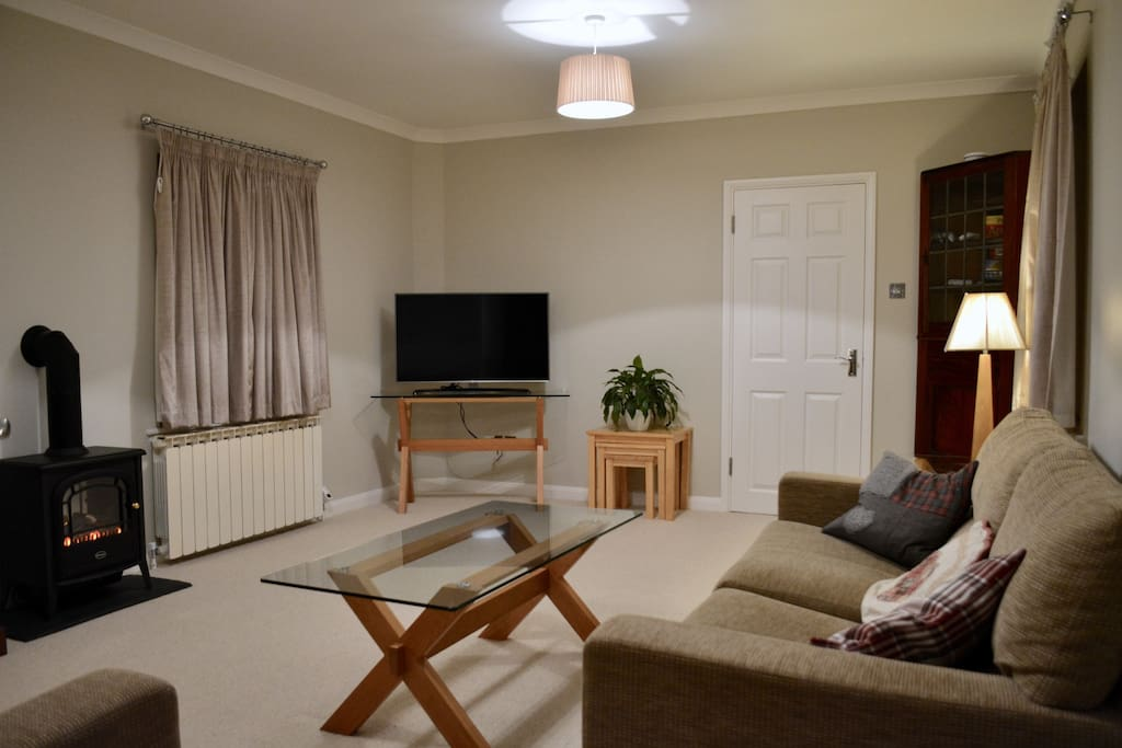 Large cozy Living Room with Internet TV (including Netflix), flame effect log burner and a selection of games and books
