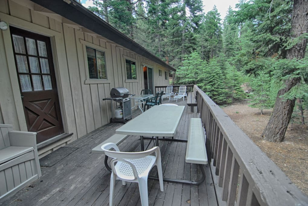 Back deck with lounge chairs and dinning area