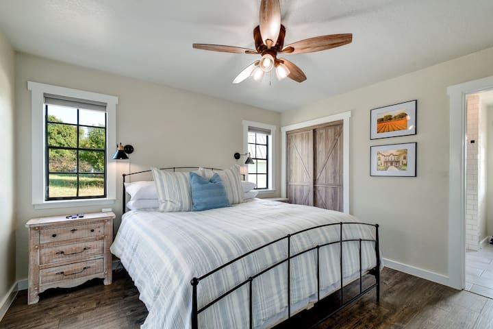 First floor King Bedroom with en-suite bathroom, bedside lights and USB ports on each bedside.