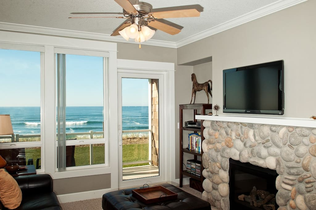 Relax In Comfortable Elegance With an LCD TV and River Rock Fireplace