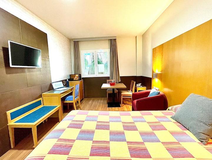 Habitación/estudio con los servicios de un hotel