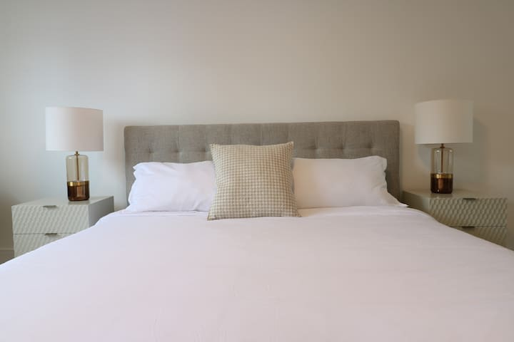 Master bedroom with a comfy king size bed