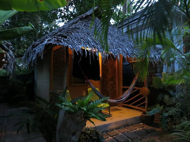 Accommodation is located in breezy, tropical garden. All rooms have built-in bathrooms (hot water on request), fan, clean bedding, towels. Balcony area includes tables, chairs and super comfy hammock!