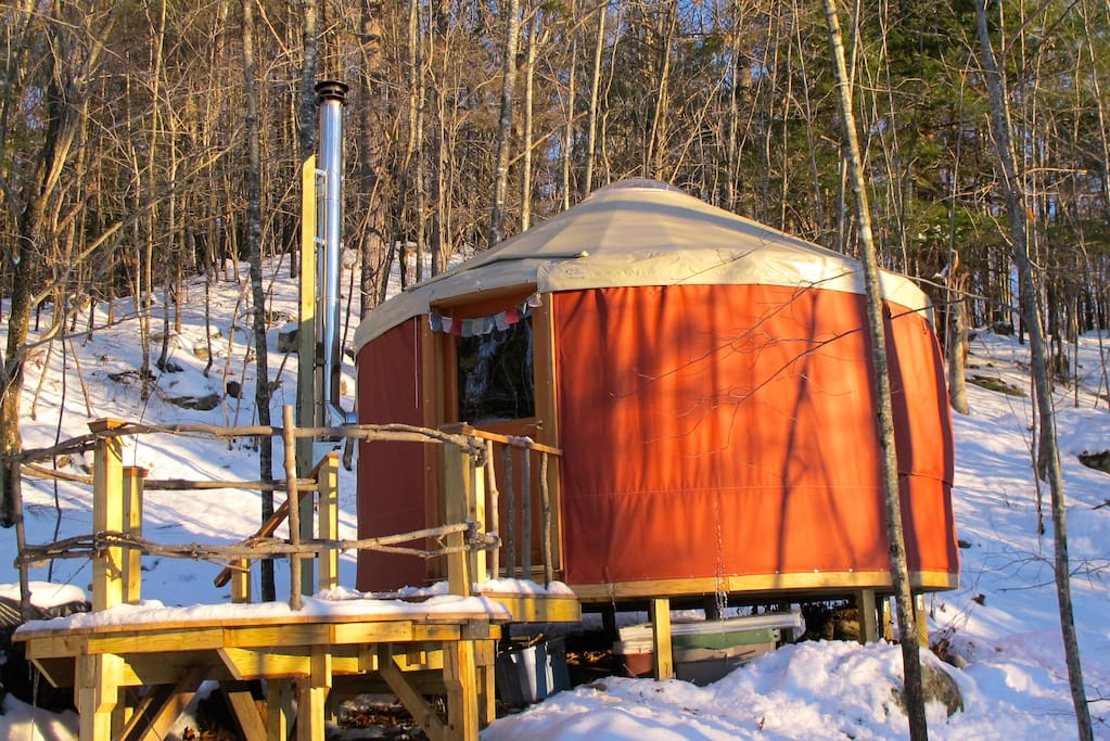 Sunset Yurt tucked in the woods on a winter morning
