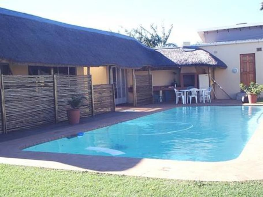 Pool with rooms and outdoor barbecue area