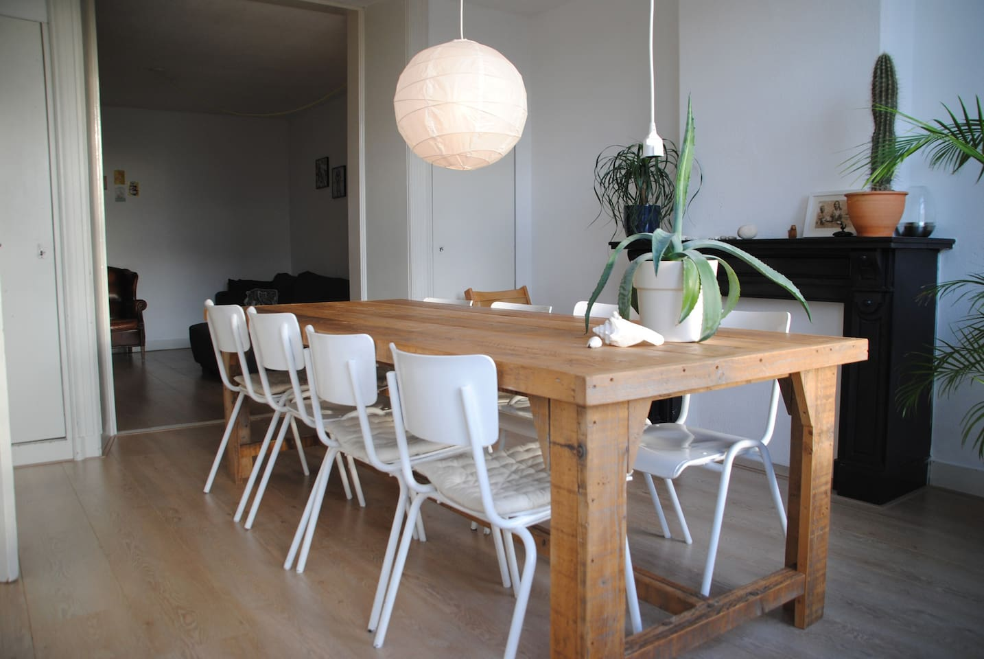 Dining room with big table and Stokke TripTrap baby chair.