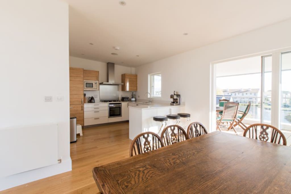 Modern kitchen is located next to the dining so cooks never need miss out