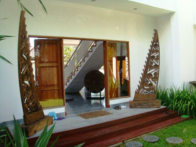 Entrance from garden to villa