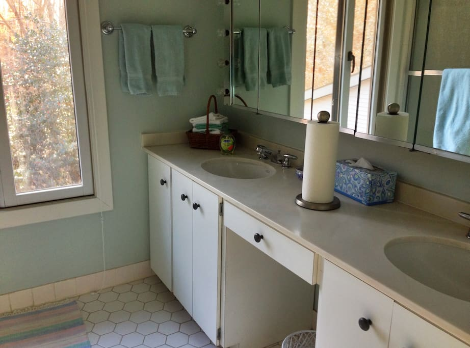 .En suite bathroom with double sinks, tub and shower
