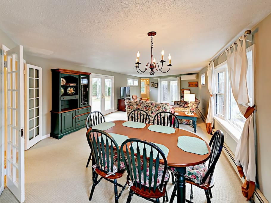 The elegant dining room, living room, and play room offer ample space for your group.