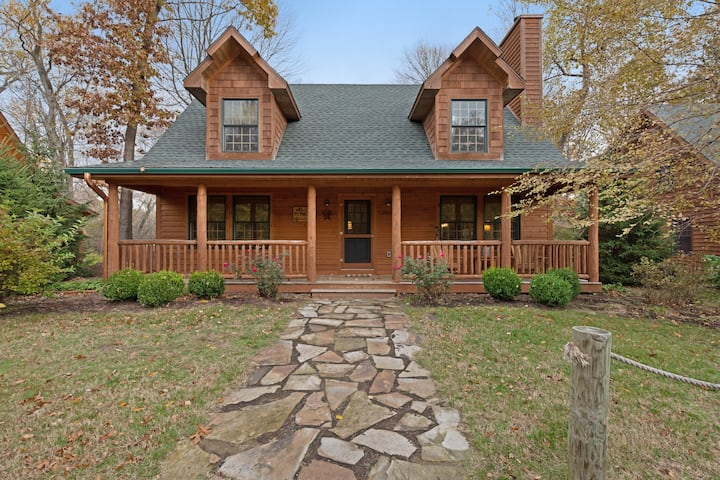 Log-cabin-style home with hot tub and close proximity to the lake!