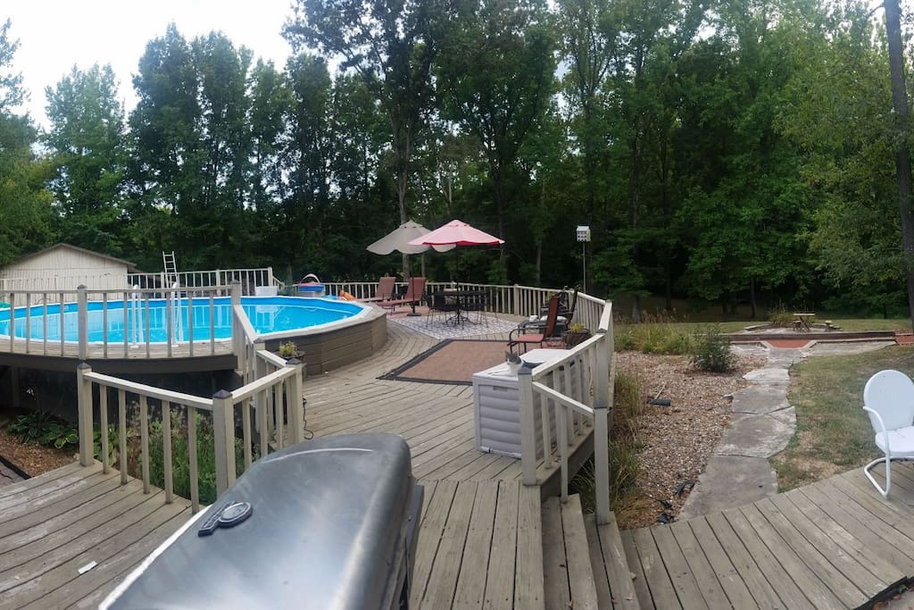 Pool area with large deck, patio furniture,grill and prep table, smoker and outdoor stereo system