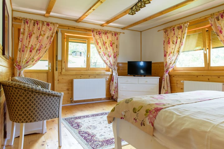 Second bedroom on the second floor. View to Piatra Craiului Mts.