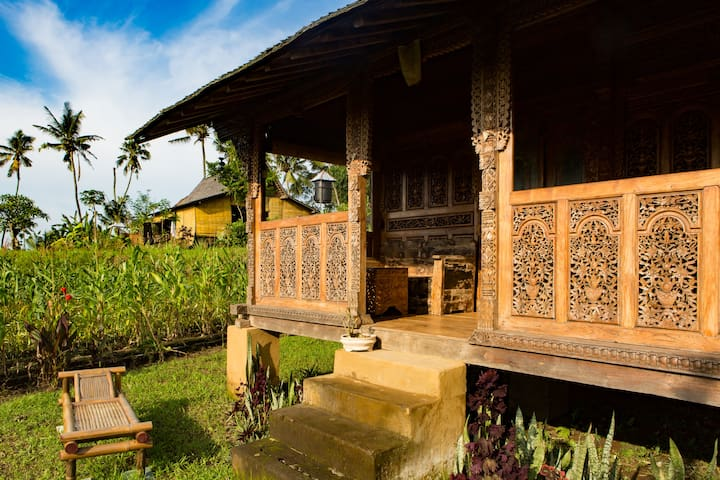 carved house -the other teak house is behind and on a different layer