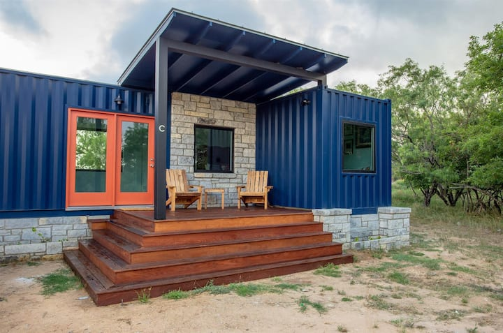 Shangri La at Odonata Escape -- Modern container home room with a touch of the East