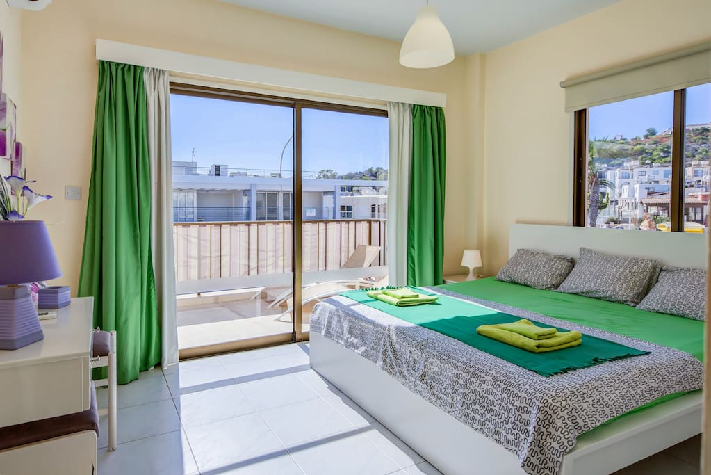 Large King Size Bed with Balcony Views of Fig Tree Bay
