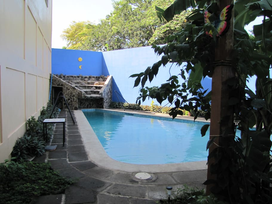 14,000 gallon lap pool with water feature