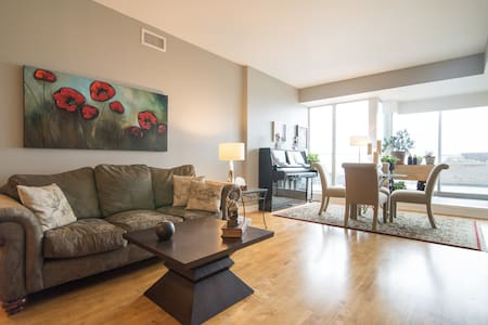 Bright, spacious well appointed 2 bedrm, 2 full bath, huge patio. Centrally located in hip, walkable neighbourhood. Quiet space on main street lined with great shops, incredible restaurants, bars, banks & easy access to transit.