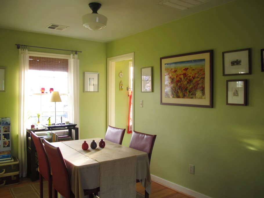 Art and light filled dining room.
