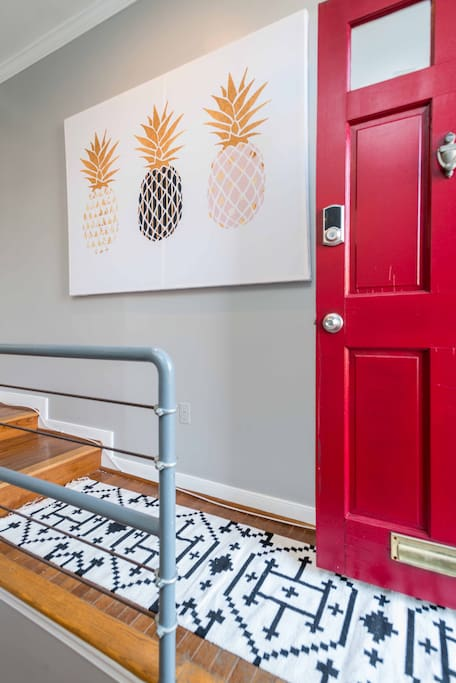 Walking into our pineapple-themed breakfast nook! Note the front door with electronic key pad for easy, hassle-free access
