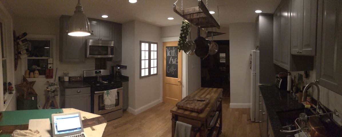 Kitchen with custom eat in table for 4.