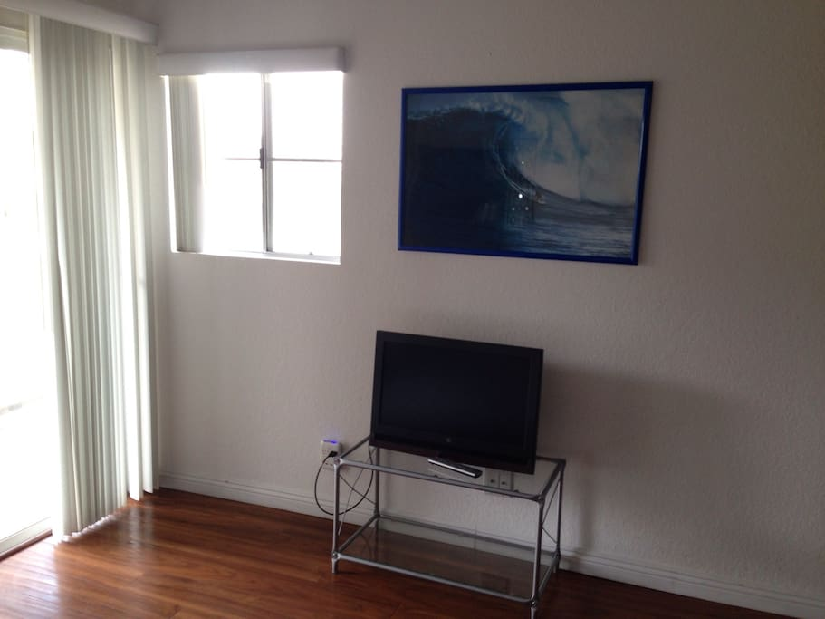 TV in room with laptop connections & charging station