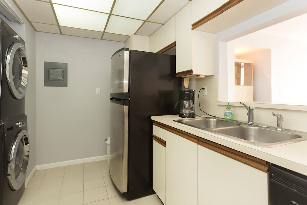 Huge washer dryer and fully equipped kitchen.