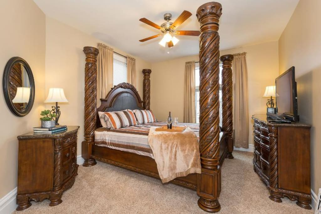 This Master Bedroom is stunning with this 4 poster bed and matching furniture!