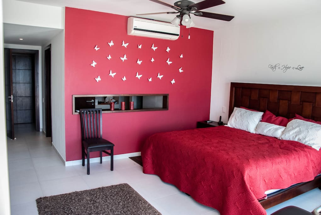 Comfortable master bedroom with full en-suite including jet tub and shower.  Also has endless closet space.  Large full length windows and terrace doors invite the sound of the ocean waves with a breath taking view of the sunrise over the ocean every morn