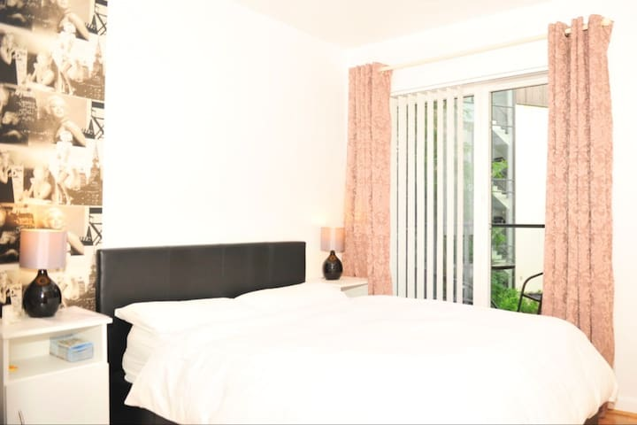 Double bed with private bathroom and balcony