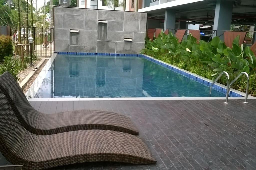 The pool area with sunbed