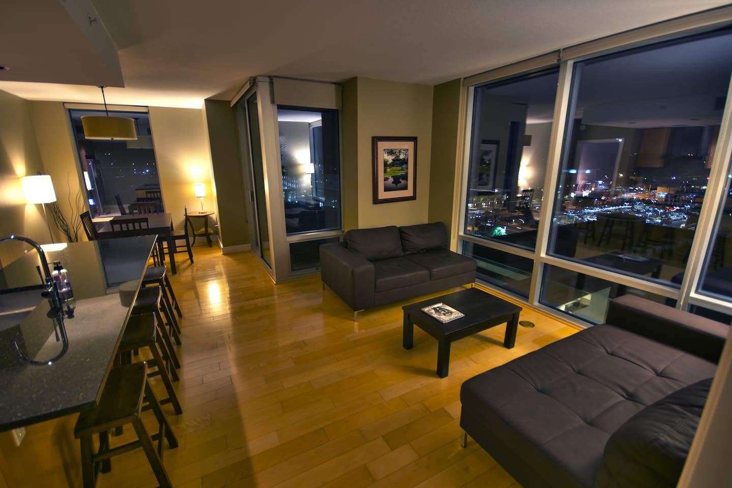 Open living room with floor to ceiling windows throughout.