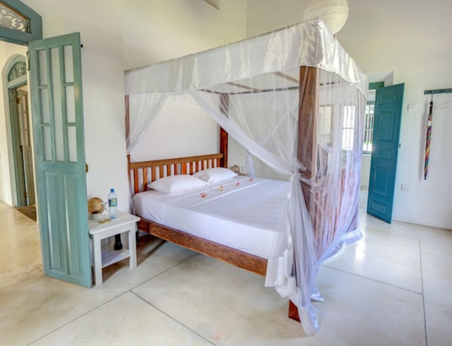 Bedrooms with four poster beds and attached bathrooms