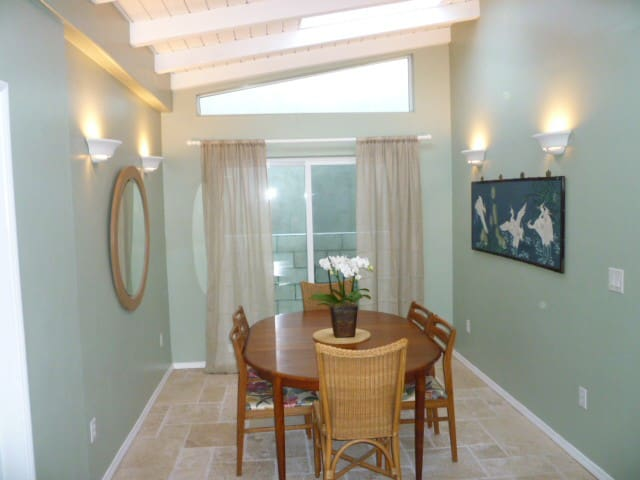 Large dining room with sky lights and sliding door