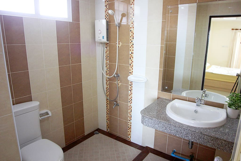 A modern private bathroom in each room.