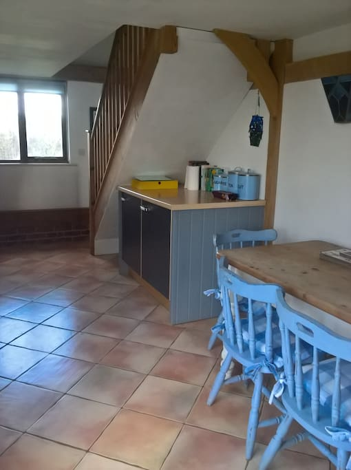 Room to eat in the kitchen which includes fridge and freezer