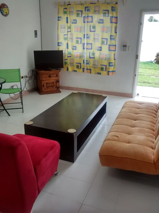 Living room area with Front Door View.  Cable & WiFi.  Futon can be used to sleep.