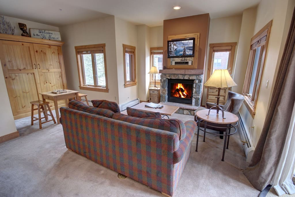 Cozy up to the fireplace and enjoy a good book after a long day of skiing.
