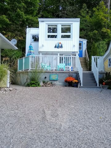 The cottage is located in a very quiet neighborhood.   Cottage is in close proximity to other cottages. It is nestled amongst a woodland hillside, with lakeviews.