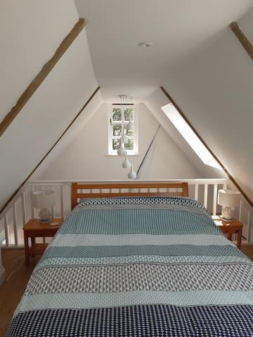 Double bed on mezzanine floor