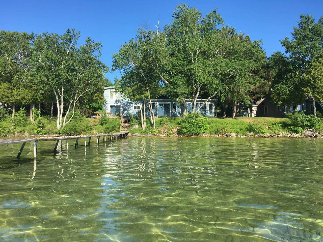 Welcome to your lovely Torch Lake Home, right on the shoreline!