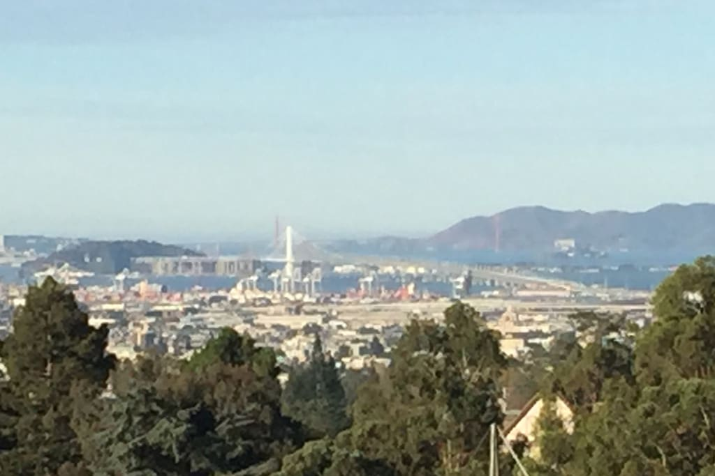View from windows - white tower is the Bay Bridge, Golden Gate bridge beyond.