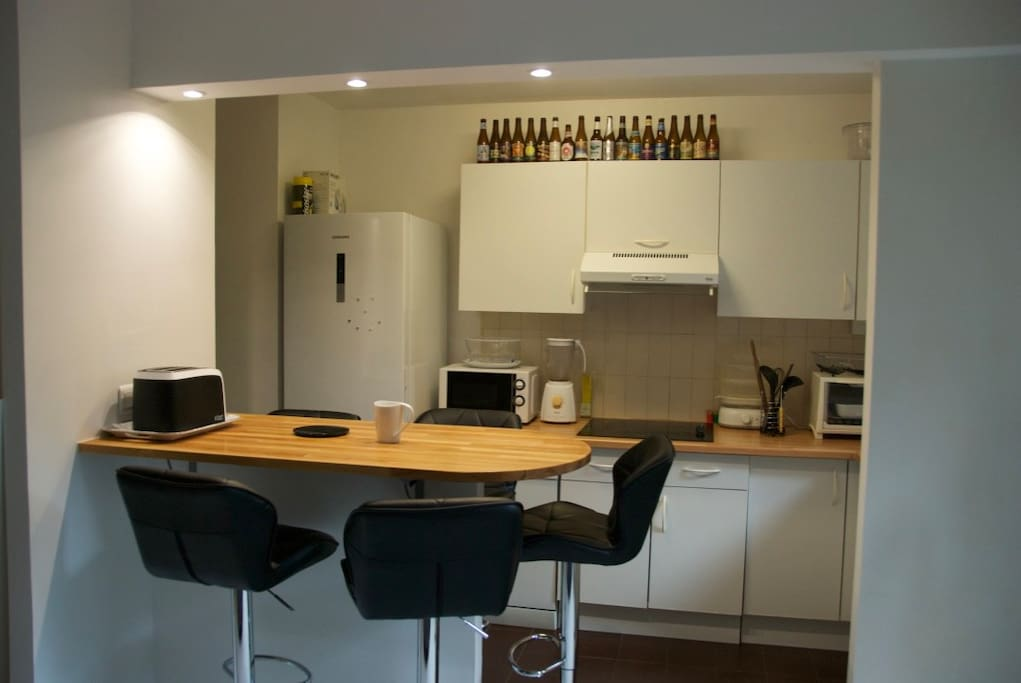 kitchen with bar and all amenities