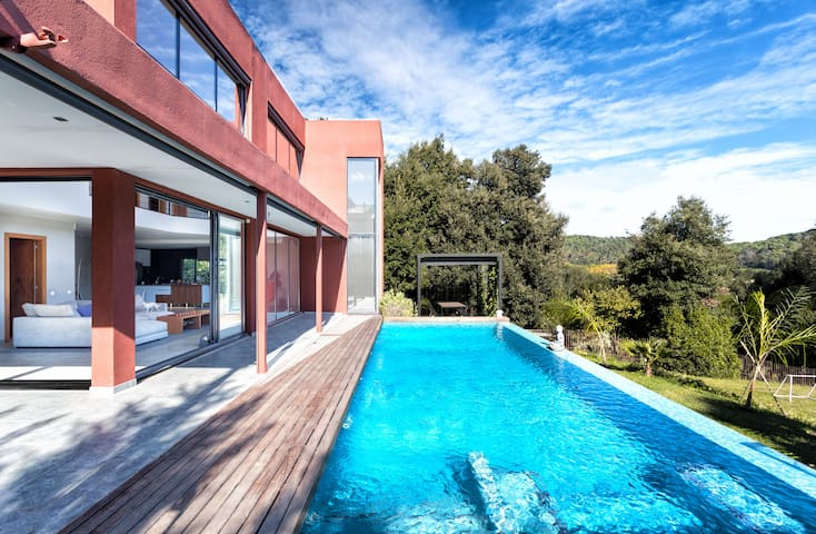 Modern designer house with infinity pool.