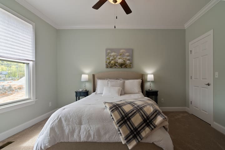 Our spacious, queen-sized bed is fitted with soft sheets, a plush comforter, and plenty of pillows.